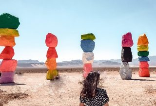 """""""Seven Magic Mountains is an artwork of thresholds and crossings, of balanced marvels and excessive colors, of casting and gathering and the contrary air between the desert and the city lights."""" -Ugo Rondinone 🎨 ⛰ 🏜   I'm sure you've seen this famous (temporary!) Nevada landmark before, but that is what the artist has to say about it!! ⬆️   Have you ever been? I actually haven't! My fam is traveling NV, CA and HI without me (rude 😂) so get ready for a lot of pics featuring my sister!! But she's wearing my jumpsuit so I'm basically there lol 😆   Swipe right to see the process of getting this photo! Original ⏩ Crop ⏩ Remove blemishes (kinda) ⏩ Add filter & edit in Lightroom. (but in reverse)  What do you think?   📍: 🇺🇸   ___________________ #sevenmagicmountains #sevenmagicmountains💜💛💚💙❤️ #ugorondinone #rainbowaesthetic #ig_color #lasvegas #lasvegaslocals #lasvegasnevada #vegas #nevadadesert"""